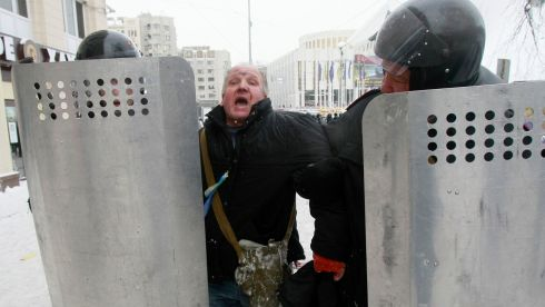 A man reacts while being escorted by interior ministry members during a rally held by pro-European protesters in Kiev. Photograph: Gleb Garanich /Reuters