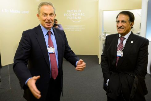 Former British prime minister Minister Tony Blair speaks with Sheikh Abdullah Bin Mohammed Al Thani , chairman of Ooredoo of Quatar on the second day of theWorld Economic Forum (WEF), in Davos, Switzerland, 23 January 2014. Photograph: Laurent Gillieron/EPA