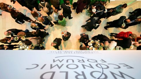 Participants stand in the lobby of the congress centre on the first day of the 44th Annual Meeting of the World Economic Forum, WEF, in Davos, Switzerland,. Photograph: Laurent Gillieron/EPA