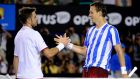 Stanislas Wawrinka (Switzerland, left) shakes hands with Tomas Berdych of the Czech Republic after winning their semi-final at the Australian Open tennis championship in Melbourne.