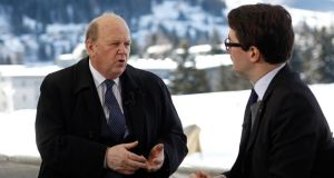 Minister for Finance Michael Noonan speaks John Fraher, a managing editor at Bloomberg News, during a Bloomberg Television interview at the World Economic Forum (WEF) in Davos, Switzerland. Photographer: Simon Dawson/Bloomberg