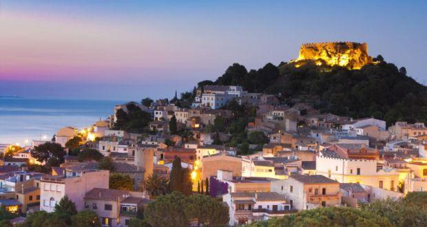 Begur village and castle at dusk