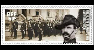 The 60 cent stamp, issued this morning, features a black and white photograph of about 20 uniformed volunteers headed by a mustachioed man identified as Cpt Jack White (also inset right).