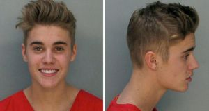 A handout combination of booking images released by the Miami-Dade Corrections & Rehabilitation Dept showing Canadian singer Justin Bieber who was arrested early this morning on charges of driving under the influence, driving with an expired license and resisting arrest following an alleged drag racing incident in Miami Beach, Florida. Photograph: EPA