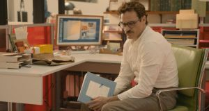 Joaquin Phoenix in Her, which tells the story of a man's relationship with his computer operating system