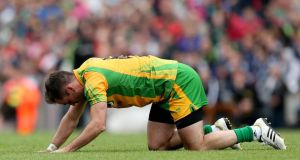 Donegal's Karl Lacey looks dejected after his side's All-Ireland quarter-final loss to Mayo. Photograph: James Crombie/Inpho