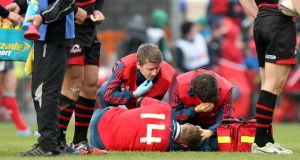 Munster's Keith Earls is out for up to eight weeks. Photograph: James Crombie/Inpho