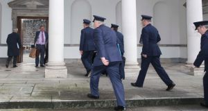 Garda Commissioner Martin Callinan leads a group of colleagues into Leinster House for the Public Accounts Committee meeting yesterday. Photograph: Sam Boal/Photocall Ireland