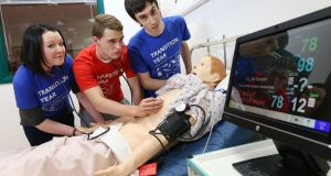 From left Elizabeth Moylan (15) from Manor House, Raheny, Dublin, Lee Sherlock,(16) from Marian College, Ringsend, Dublin and Patrick Murphy (16) from St Benildus College, Kilmacud, Dublin take part in the RCSI Transition Year (TY) MiniMed programme in Beaumont Hospital.