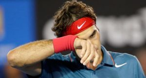 Roger Federer feels the pressure on his way to semi-final defeat against great rival Rafael Nadal at the Australian Open in Melbourne. Photograph: Made Nagiepa/EPA