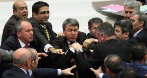 Ruling party politicians (right), and the members of the main opposition brawl in Turkey's parliament during a debate over a corruption scandal that has ensnared prime minister Recep Tayyip Erdogan's government. Photograph: AP
