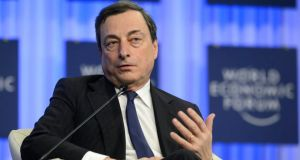 ECB president Mario Draghi speaking during a panel session on the third day of the World Economic Forum in Davos yesterday. Photograph; Laurent Gillieron/EPA