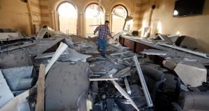 A man walks over rubble inside the Islamic Art Museum after a bomb attack in downtown Cairo today. Photograph: Mohamed Abd El Ghany/Reuters