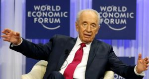 Shimon Peres: the 80-year-old Israeli head of state said languages opened doors to opportunity and progress  during a session at the annual meeting of the World Economic Forum  in Davos yesterday. Photograph: Reuters