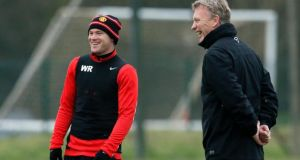 Manchester United manager David Moyes shares a laugh with Wayne Rooney  at the club's Carrington training complex in Manchester. Photograph: Phil Noble/Reuters