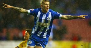James McClean of Wigan Athletic celebrates his winning goal during the  FA Cup fourth-round match against Crystal Palace at the DW Stadium. Photograph: Clive Mason/Getty Images