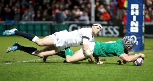 Ireland Wolfhounds scrumhalf Isaac Boss scores the opening try in the game against the England Saxons at Kingsholm in Gloucester. Photograph: Dan Sheridan/Inpho