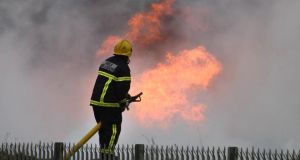 A spokesman for the Dublin Fire Brigade said they were still taking calls from residents on the northside of Dublin who were concerned about smoke still being emitted from the site. Photograph: Dara Mac Dónaill/The Irish Times