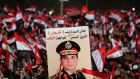 Supporters of Egypt's army chief General Abdel Fattah al-Sisi holds a poster of Sisi in Tahrir square in Cairo, on the third anniversary of Egypt's uprising yesterday. Photograph: Mohamed Abd El Ghany/Reuters