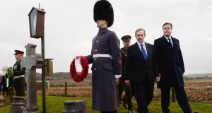 Taoiseach Enda Kenny and British prime minister David Cameron visit the grave of Irish MP Willie Redmond, who died in the first World War, in Heuvelland, Belgium, last month. Photograph: Stefan Rousseau/PA Wire.