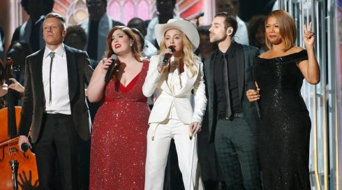 Macklemore, Mary Lambert, Madonna, Ryan Lewis and Queen Latifah perform gay rights song Same Love during a marriage ceremony for 33 couples, some of them same-sex, at heavyweight music industry awards the Grammys in LA.  Photograph: Mario Anzuoni/Reuters
