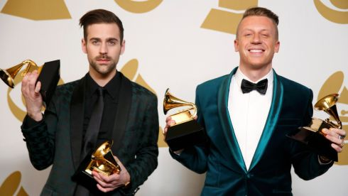 Hip hop artists Macklemore (right) and Ryan Lewis pose backstage with their awards for Best New Artist, Best Rap Performance for Thrift Shop, Best Rap Song for Thrift Shop and Best Rap Album for The Heist at the 56th annual Grammy Awards in Los Angeles, California. Photograph: Lucy Nicholson/Reuters