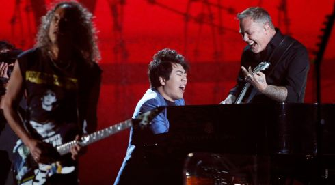 In case you didn't get it, that's Lang Lang doing his One thing with Metallica. Photograph: Mario Anzuoni/Reuters