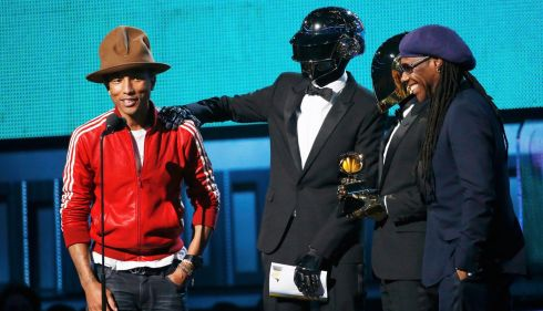 Those spacesuit men Daft Punk have had a quick costume change to get their award for Best Pop Duo/Group Performance, with Pharrell Williams (left) and the one and only Nile Rogers. Photograph: Mario Anzuoni/Reuters