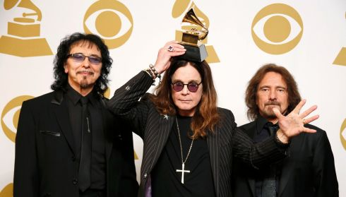 Musicians Tony Iommi (left), Ozzy Osbourne (goofing about, surprise) and Geezer Butler of Black Sabbath pose with their award for Best Metal Performance for God is Dead? Photograph: Lucy Nicholson/Reuters
