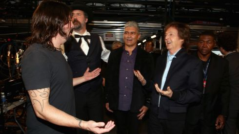It's the backstage love time: Dave Grohl (left) and Paul McCartney (right) get ready for a hug with Grohl's former Nirvana buddies Krist Novoselic (necktie) and Pat Smear. Photograph: Christopher Polk/Getty Images