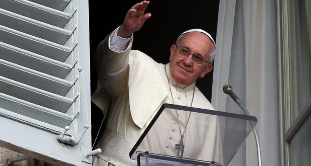 Pope Francis waves during the Angelus prayer in Saint Peter's square at the Vatican yesterday. Photograph: Alessandro/Reuters