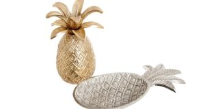 THREE OF THE BEST . . . PINEAPPLE EXPRESS Debenhams (Debenhams.ie) has some affordable accessories such as this pineapple pot, 15cm by 10cm by 10cm, €39, and aluminum pineapple dish, 22cm by 12.5cm by 2.5cm, €18, that will give your home a touch of Hollywood regency glamour.