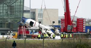 Wreckage is removed from the scene of the Manx2 air crash at Cork Airport in 2011. Photograph: Daragh Mc Sweeney/Provision