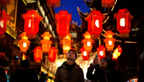 A couple look at the new year lanterns decorating the Yuyuan Garden in downtown Shanghai. Photograph: Carlos Barria/Reuters