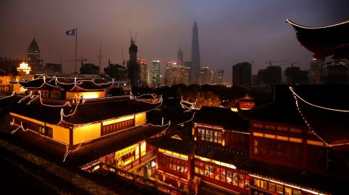 Decorations and evening views of downtown Shanghai from Yuyuan Garden. Photograph: Carlos Barria/Reuters