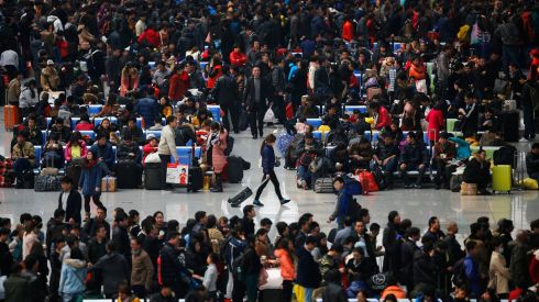 People wait for their trains at Hongqiao train station. Shanghai. About 3.62 billion trips will be made during the 40-day festival travel rush, the Xinhua News Agency said. Photograph: Carlos Barria/Reuters