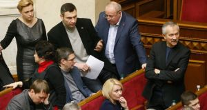 Ukrainian opposition leader Vitali Klitschko (holding paper) speaks with colleagues  during the extraordinary session of the Ukrainian parliament in Kiev yesterday.  Photograph: Sergey Dolzhenko/EPA