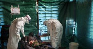 Medecins Sans Frontieres staff  treat a suspected Ebola patient in the isolation unit of Kampungu in Congo. Photograph: Reuters