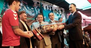 Atta Mohammad Noor (right), the governor of Balkh province,  handing out gifts in Mazar-e Sharif. Known as the King in the North, some say he is a warlord, with blood on his hands and dirty money in his vault, while others say he is a protector of his people and a champion of business and  enterprise.