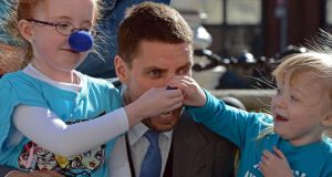 Carly (8) and Gracie (4) Fagan, from Portlaoise, whose sister Lucy is affected by autism, pictured with Keith Duffy at the 2013 launch of the Blue Nose fundraising campaign. Photograph: Eric Luke/The Irish Times