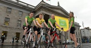 At yesterday's launch of the 2014 An Post Rás are model Aoife Cogan and Irish riders, from left, Ronan McLaughlin, Connor McConvey and Roger Aiken. Photograph: Brendan Moran/Sportsfile