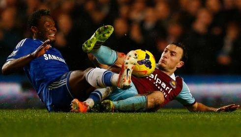 Chelsea passed up an opportunity to draw level on points with Arsenal after a scoreless draw with lowly West Ham at Stamford Bridge. This Mark Noble and John Obi Mikel (left) challenge was a good example of the underdogs' determination. Photograph: Reuters/Eddie Keogh