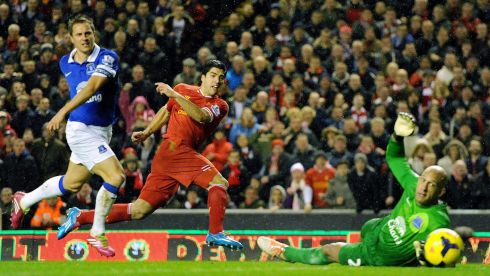 Suarez scores Liverpool's fourth with his customary panache after a run from the halfway line. Photograph: Peter Powell