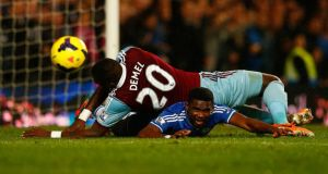 Chelsea's Sammuel Eto'o  unsuccessfully appeals for a penalty after a challenge from West Ham United's Guy Demel during the Premier League  match at Stamford Bridge. Photograph: Toby Melville/Reuters