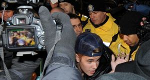Justin Bieber appears at a police station in connection with an alleged criminal assault in Toronto last night. Photograph: Jag Gundu/Getty Images