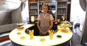 Study shows passengers will pay more for access to in-flight drinks. The bar on the upper deck of an Emirates Airbus. Photograph: Andrew Yates/AF P/Getty Images