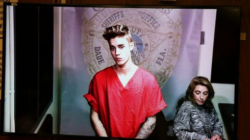 Pop singer Justin Bieber appears via video link  in his first court appearance since being arrested  in Miami, Florida, on January 23rd, 2014. Bieber was arrested in South Florida early on a drunken driving charge after he was caught drag racing on a main thoroughfare in a rented yellow Lamborghini, police said.  Photograph: Walter Michot/Pool/Reuters