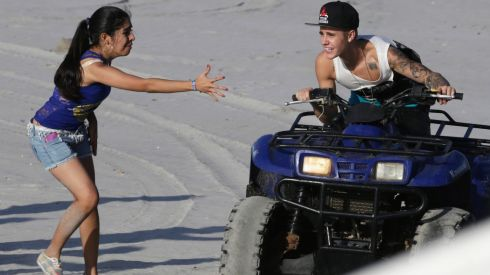 The Canadian pop singer greets a fan at a resort in Punta Chame on the outskirts of Panama City three days after his turbulent off-stage life landed him in a Florida jail. Bieber was arrested on January 23rd for drunk driving after he was allegedly drag racing on a Miami Beach street. Photograph: Carlos Jasso/Reuters