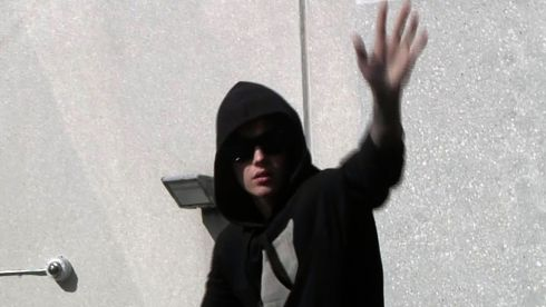 Pop singer Justin Bieber waves to fans as he leaves a jail after being released on bail. Image: Reuters TV