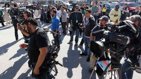 Onlookers and members of the media await the release of the teen pop star. Photograph: Andrew Innerarity/Reuters